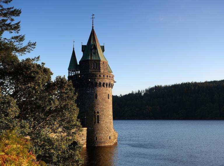 A fairytale style tower on a beautiful lake.