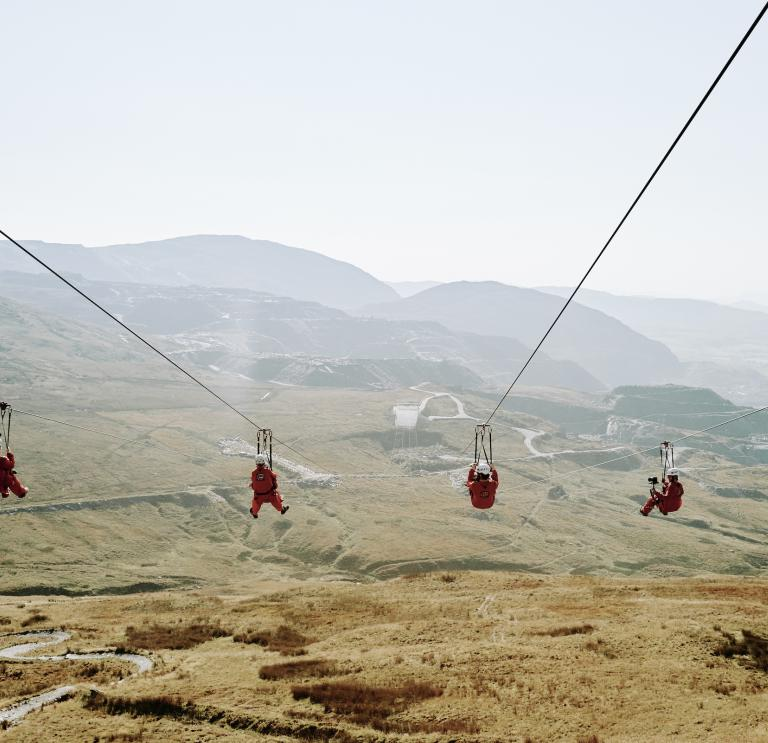 Four people on a zipwire.